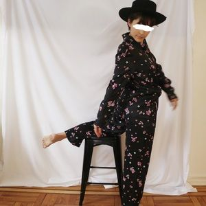 High-waisted shiny navy floral trousers